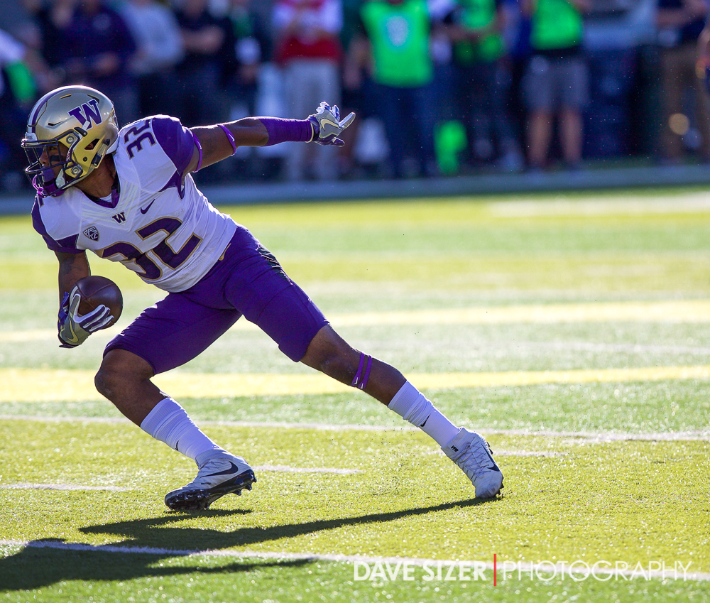 Budda Baker picks off a pass on the first play of the game.