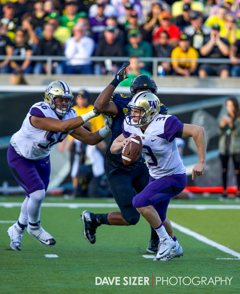 Jake Browning scrambles for yardage.