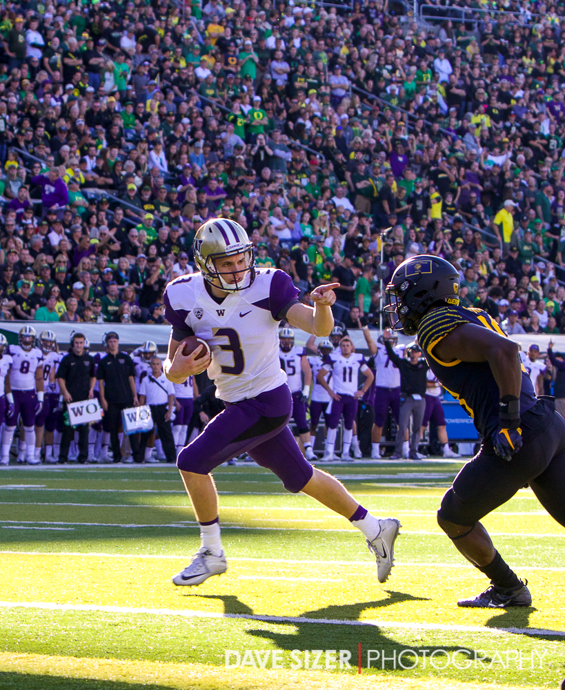 Jake Browning points at the defender as he crosses the goal line on his first drive. The point earned him a 15 yard penalty.