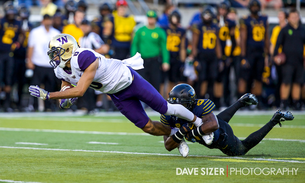 Dante Pettis gets tripped up by a defender after a big gain.