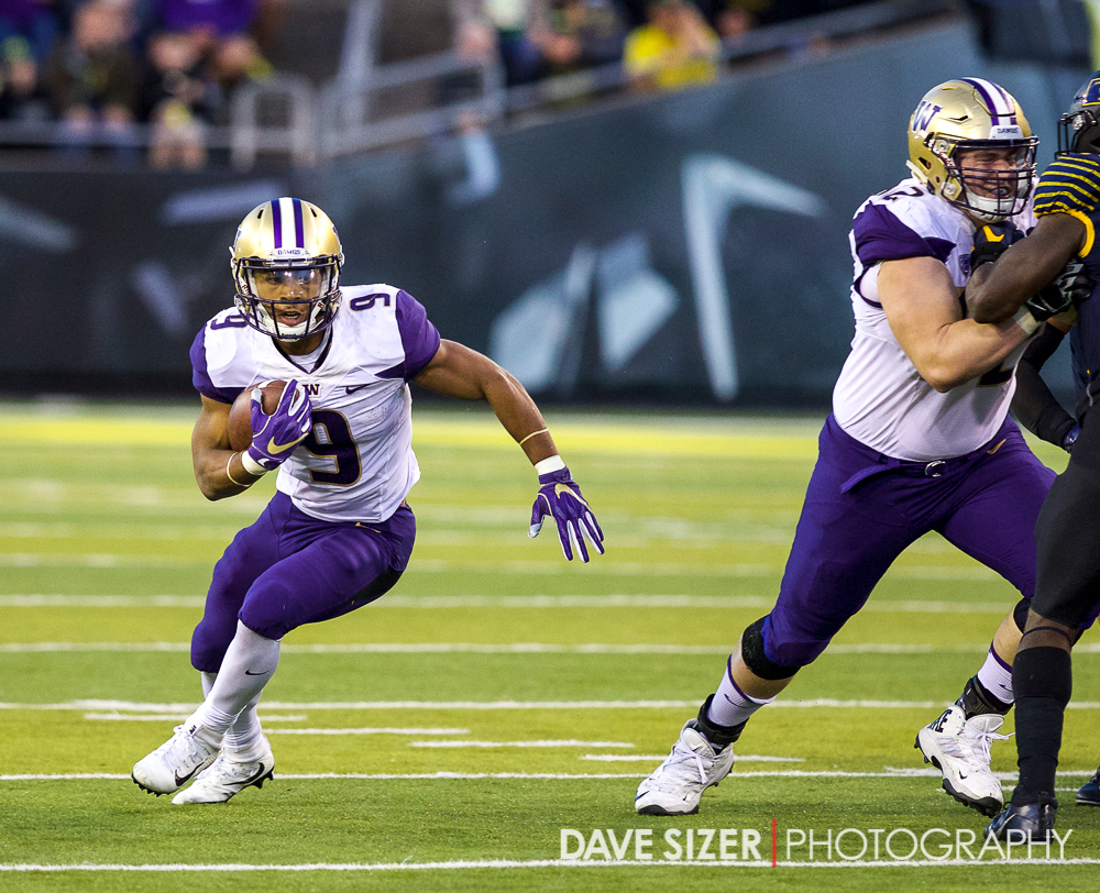 Myles Gaskin breaks around the end for daylight.
