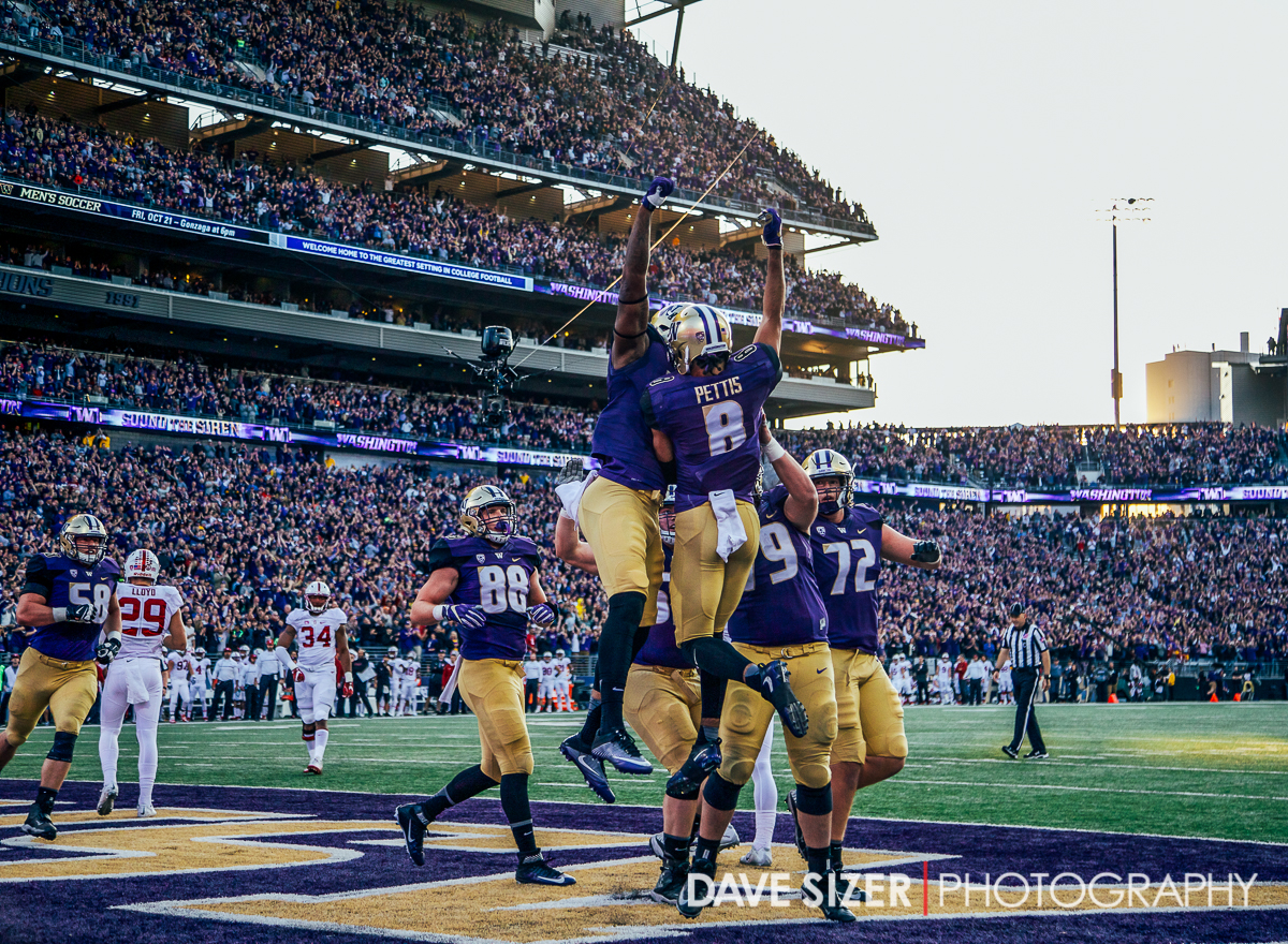 Dante Pettis and teammates celebrate after a touchdown.
