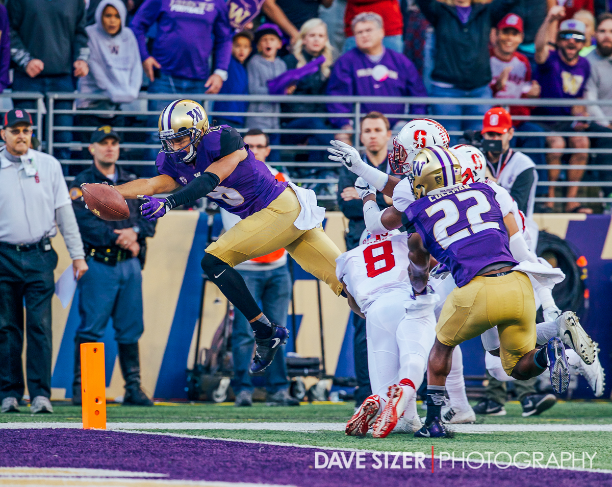 Dante Pettis leaps into the end zone for a score.