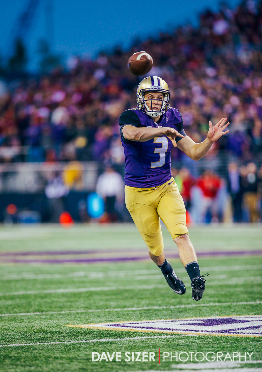 Jake Browning throws on the run.