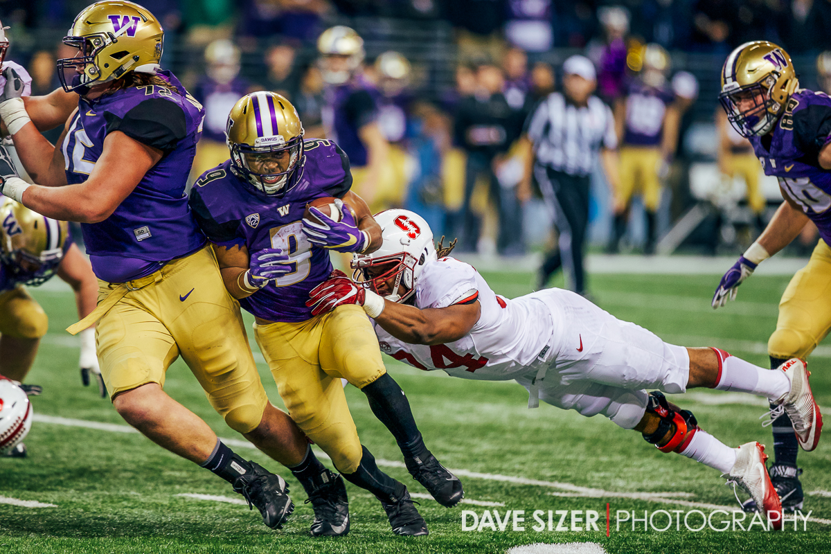 Myles Gaskin breaks away from the grasp of the Cardinal Defense.