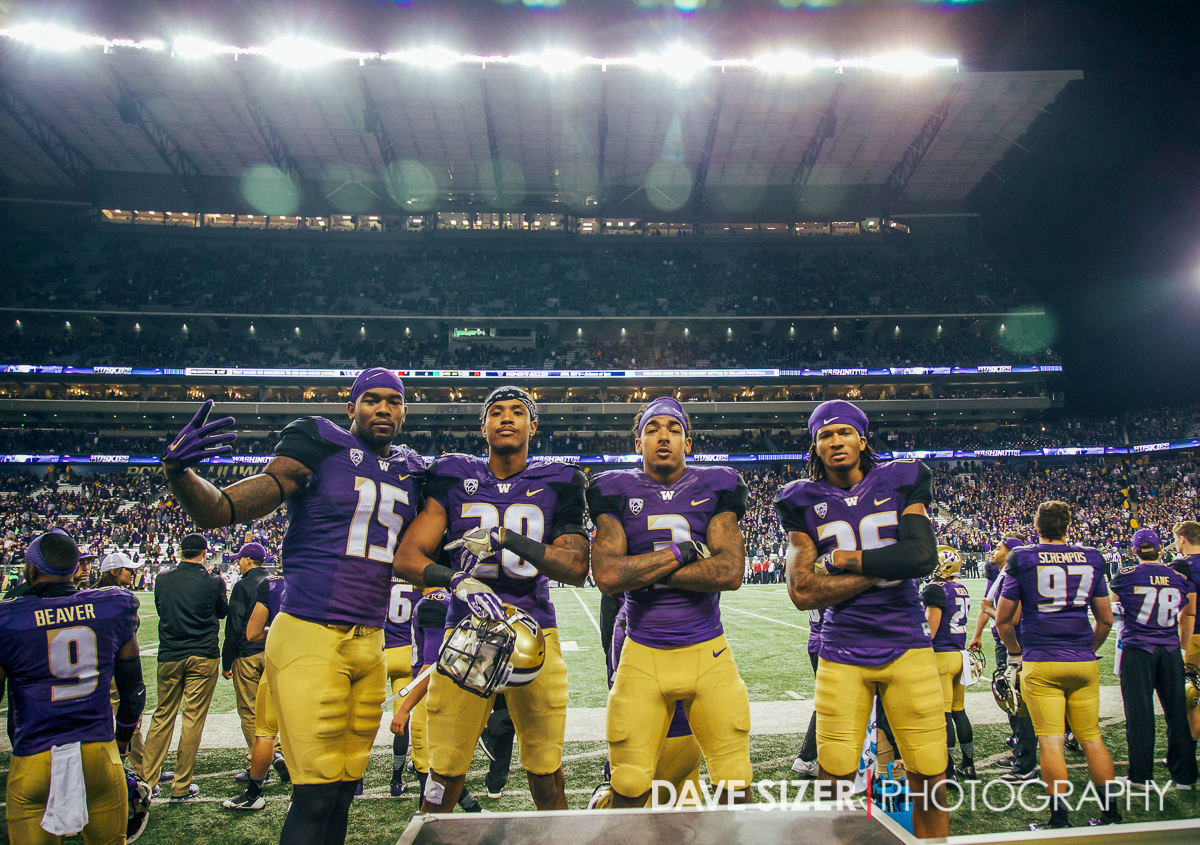 Darrell Daniels, Kevin King, Darren Gardenhire and Sidney Jones pose on the bench as the clock runs out.