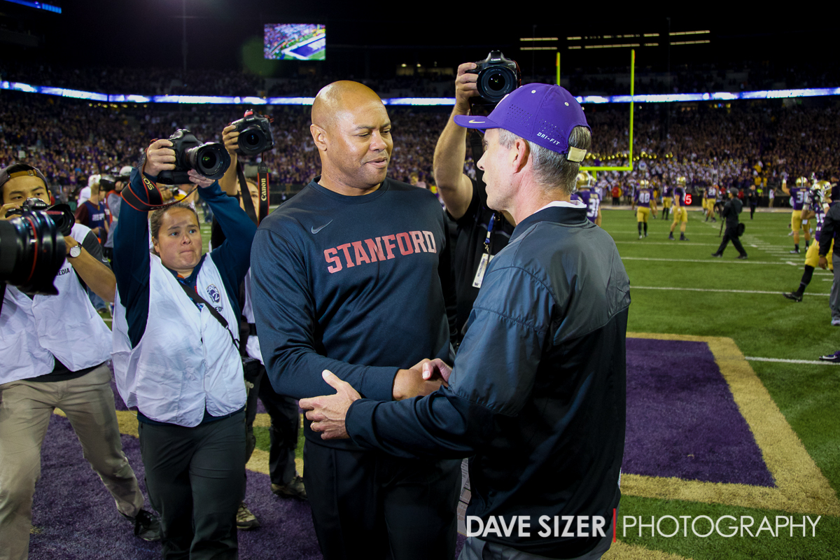 Coaches David Shaw and Chris Peterson shake hands at mid field after the game.