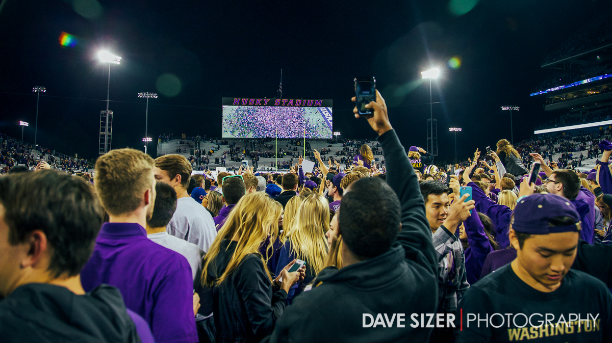 The Husky mob on the field.