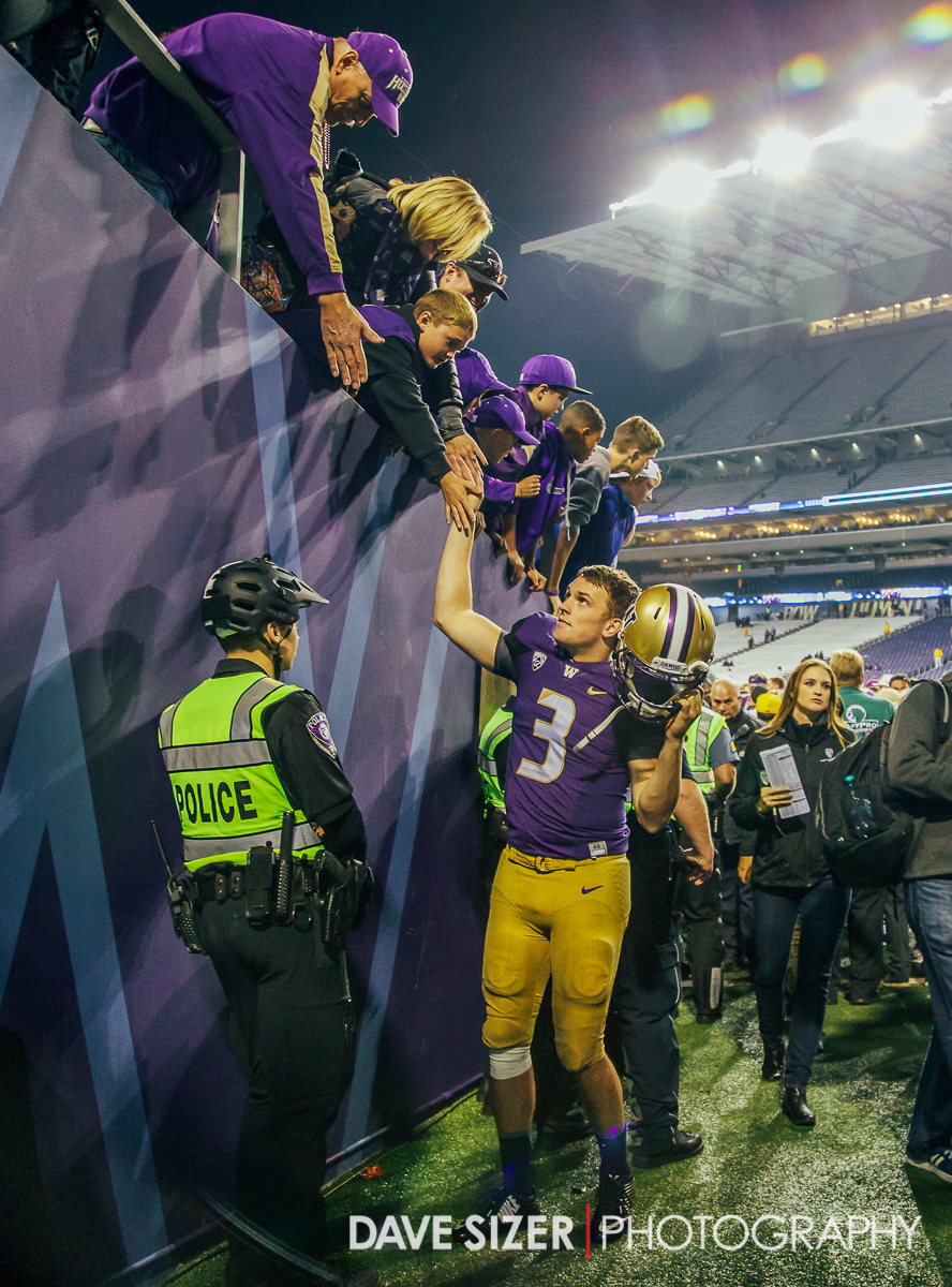 Jake Browning greets the fans on the way up the tunnel.