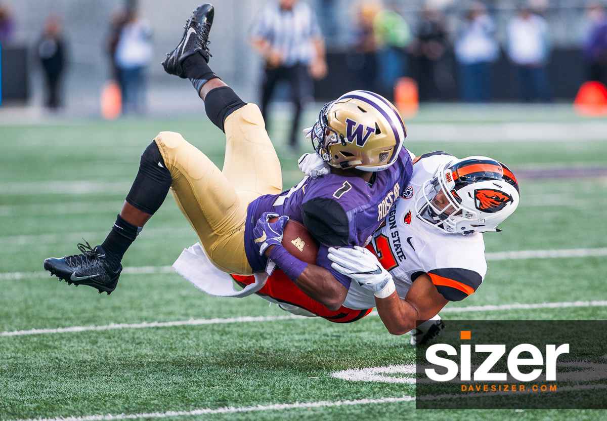 John Ross gets twisted down after a catch.