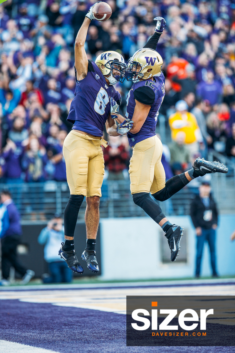 Dante Pettis and Aaron Fuller leap in celebration after a Pettis touchdown.