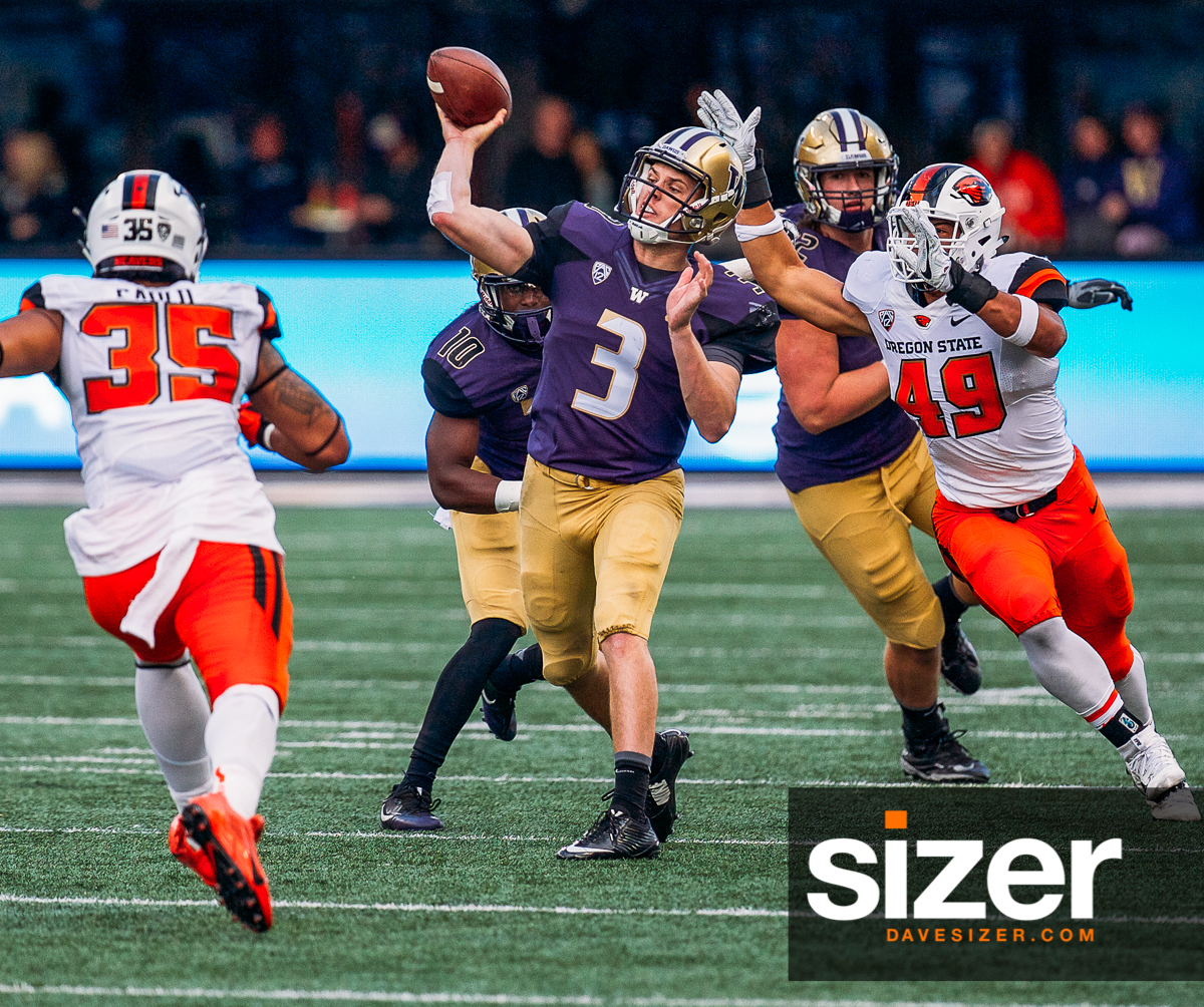 Jake Browning lets go of a pass under heavy pressure.