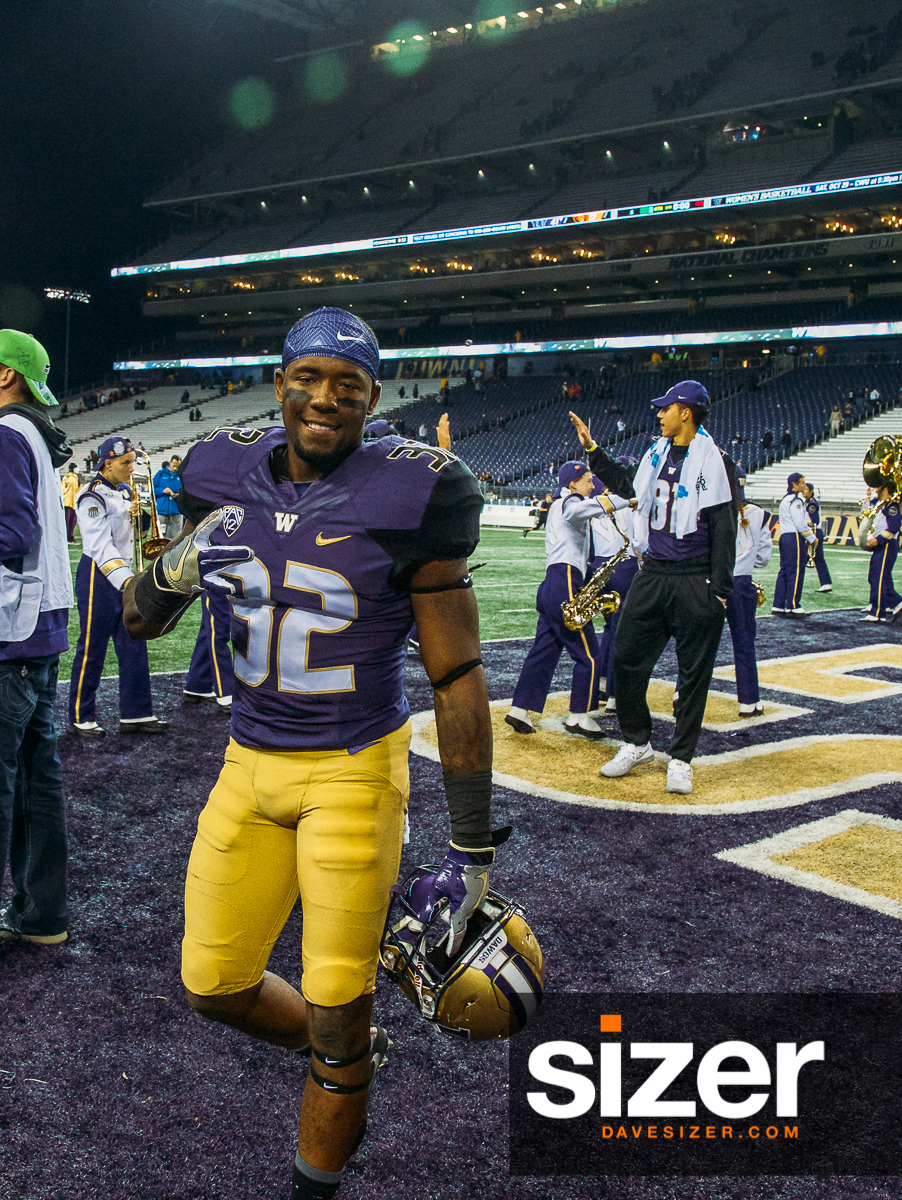 Budda Baker throws up a Dubs after the game.