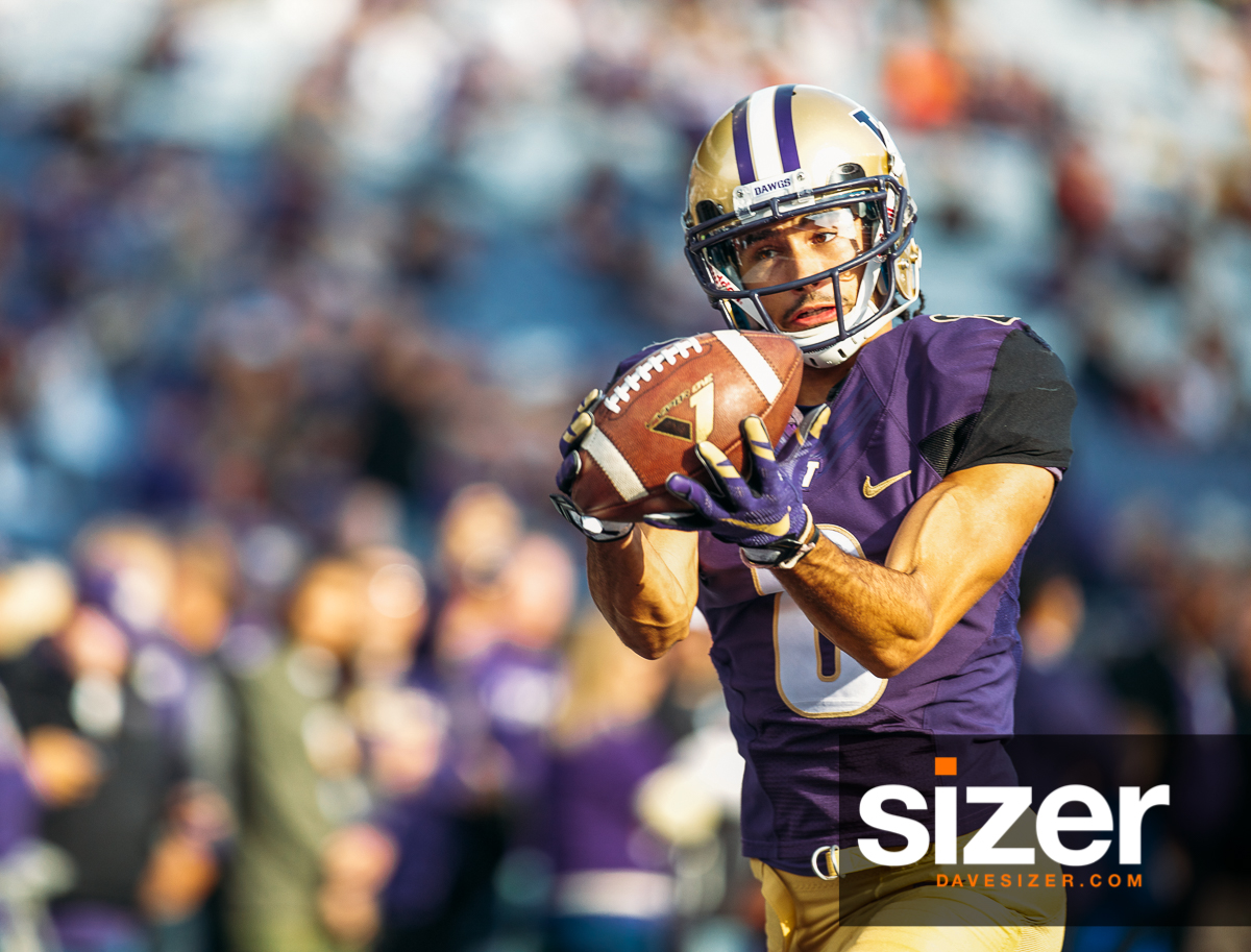 Dante Pettis keeps his eyes on the ball as he hauls in this pass.