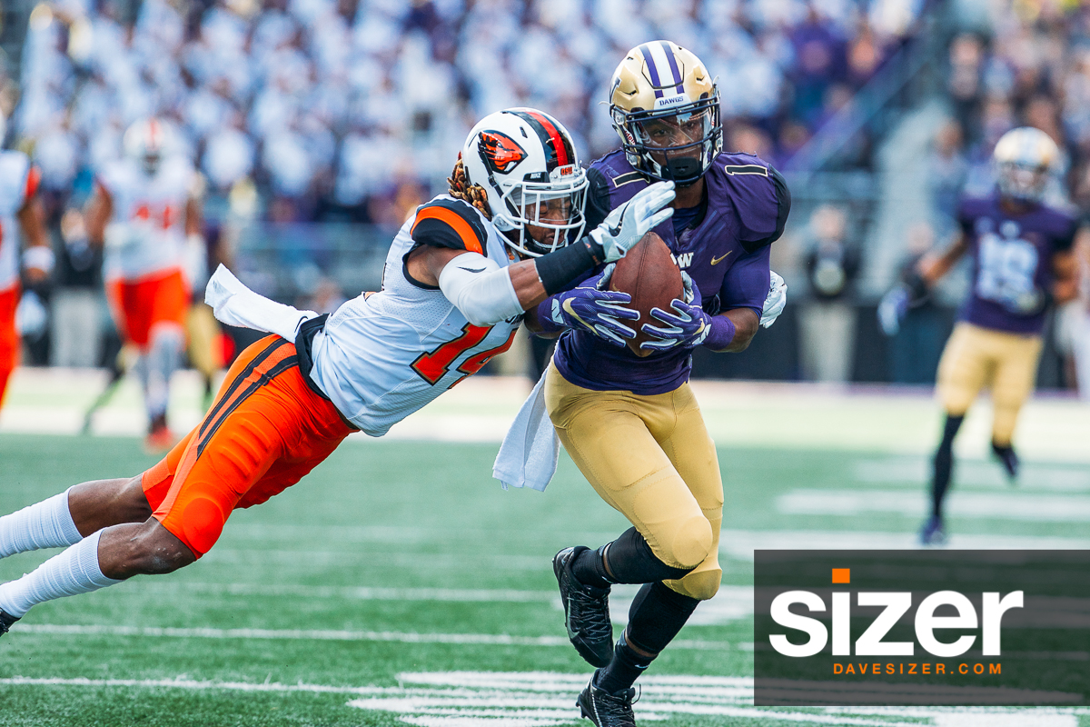 John Ross brings in this pass with a defender draped all over him.