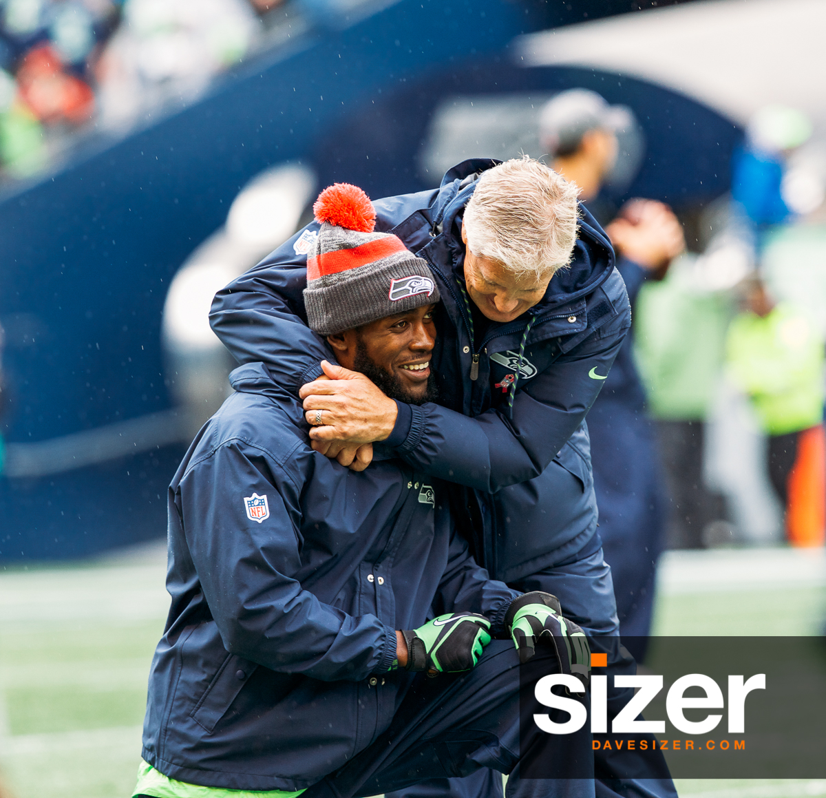 Head Coach Pete Carroll gives a big hug to Kam Chancellor, who had to sit out this game with an injury.
