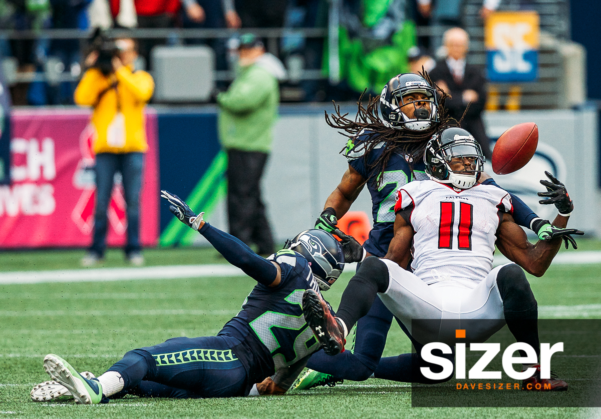 Richard Sherman and Earl Thomas break up a pass to Julio Jones on the last play of the game.