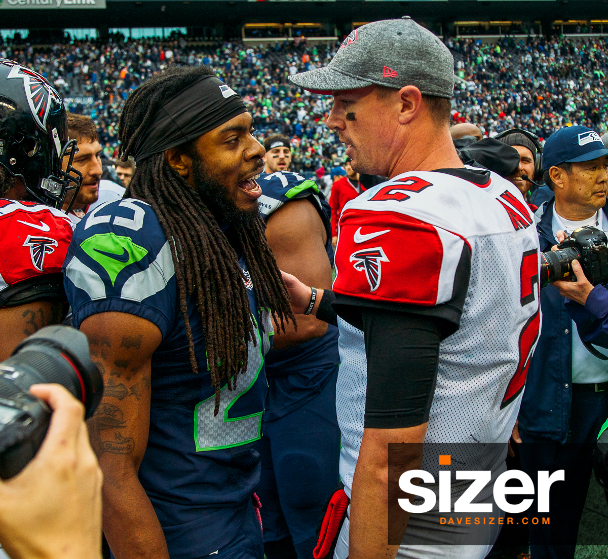 Richard Sherman and Matt Ryan chat after the game.