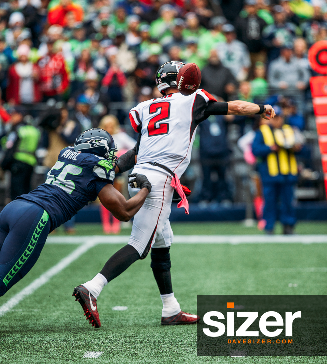 Cliff Avril strips the ball from Matt Ryan for a fumble.