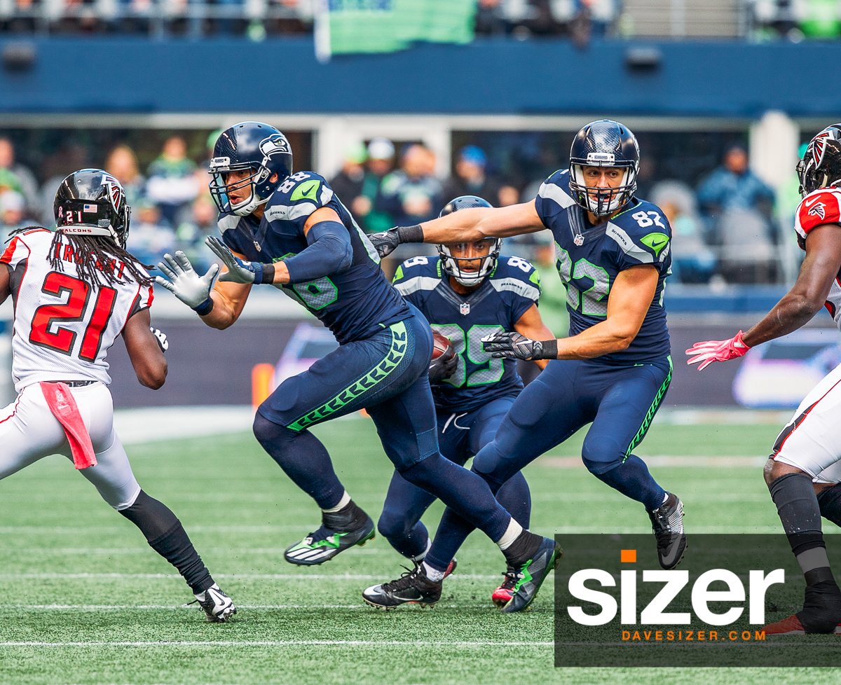 Blockers Jimmy Graham and Luke Wilson clear a path for Doug Baldwin.