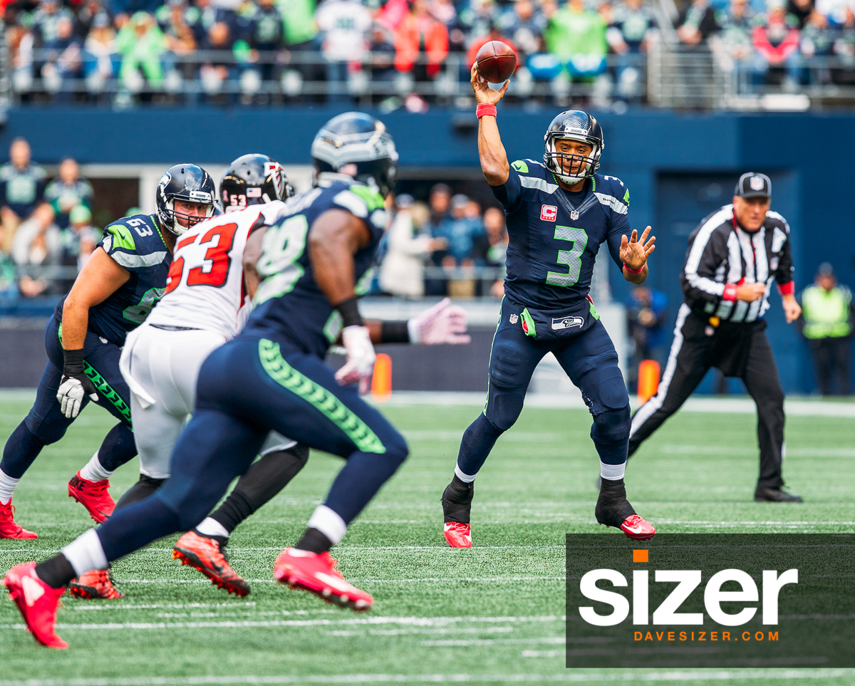 Russell Wilson throws on the run.
