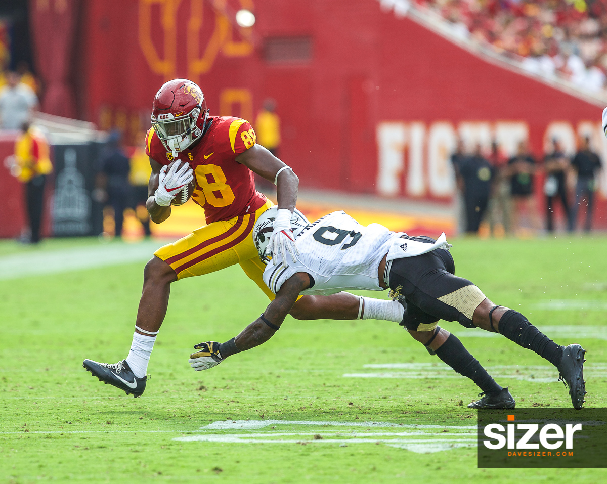 USC's Daniel Imatorbhebhe avoids the tackle as he heads for the sideline.