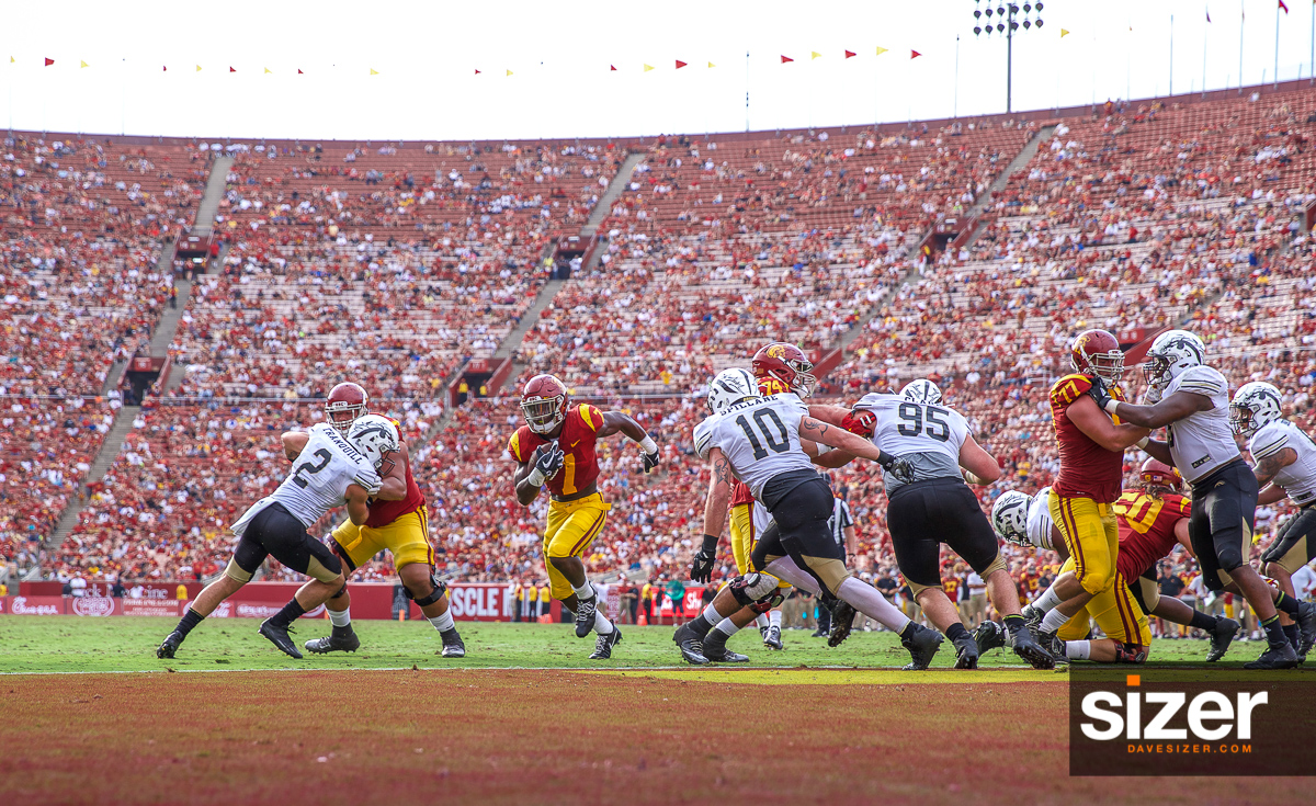 Stephen Carr finds a hole for a Trojan touchdown.