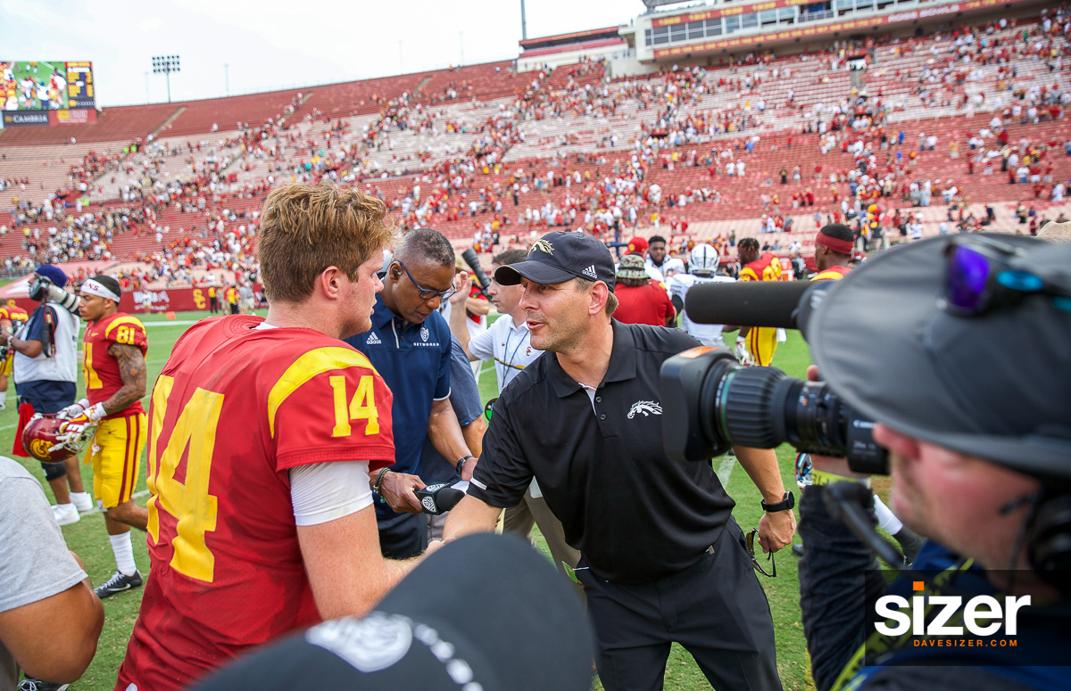 WMU Coach Tim Lester congratulates QB Sam Darnold after the game.