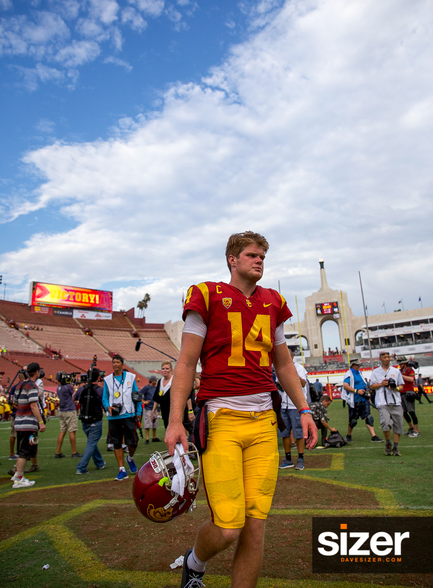 A victorious Sam Darnold leaves the field.