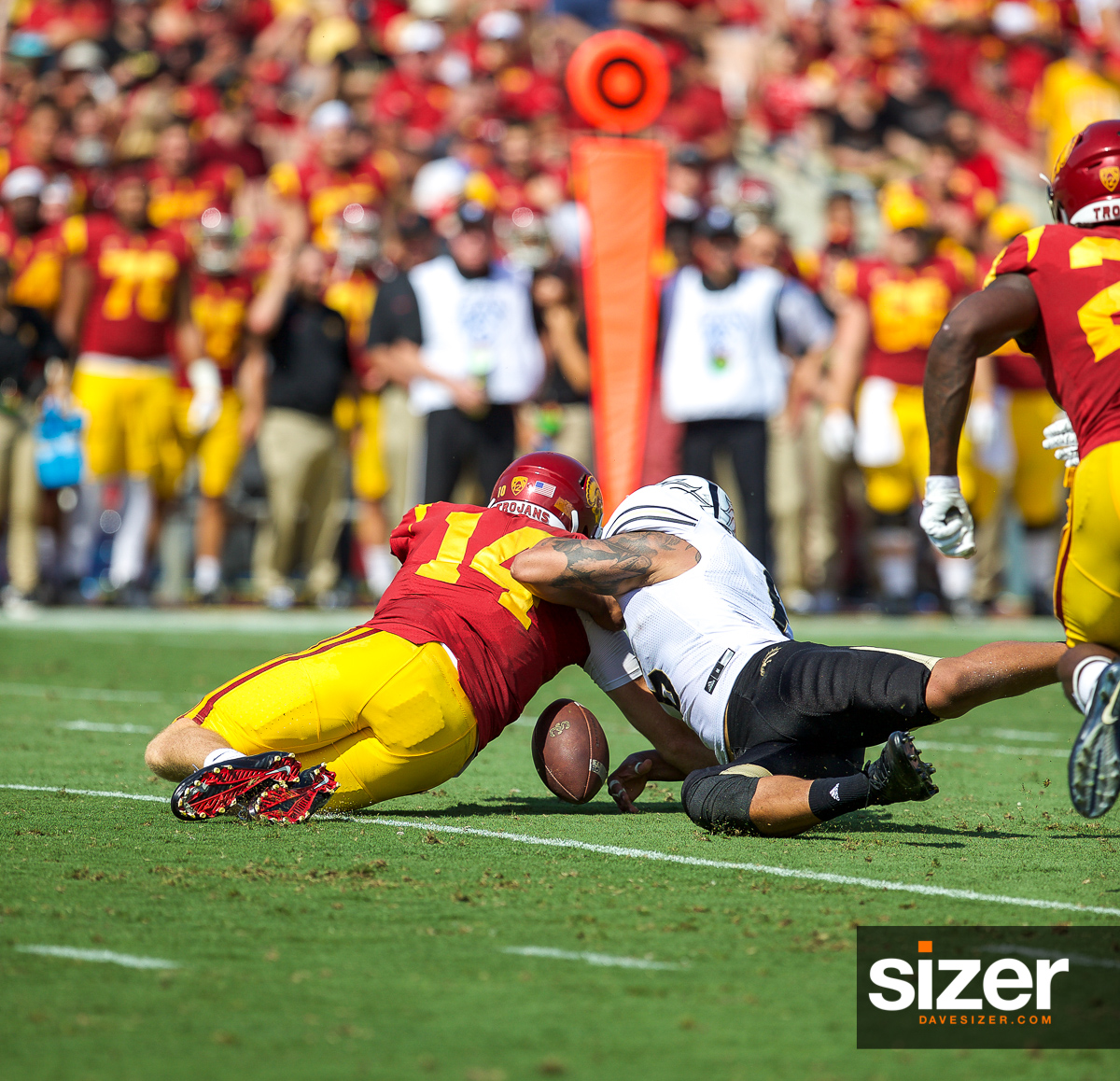 Trojan QB Sam Darnold fumbles the ball but it is recovered by USC.