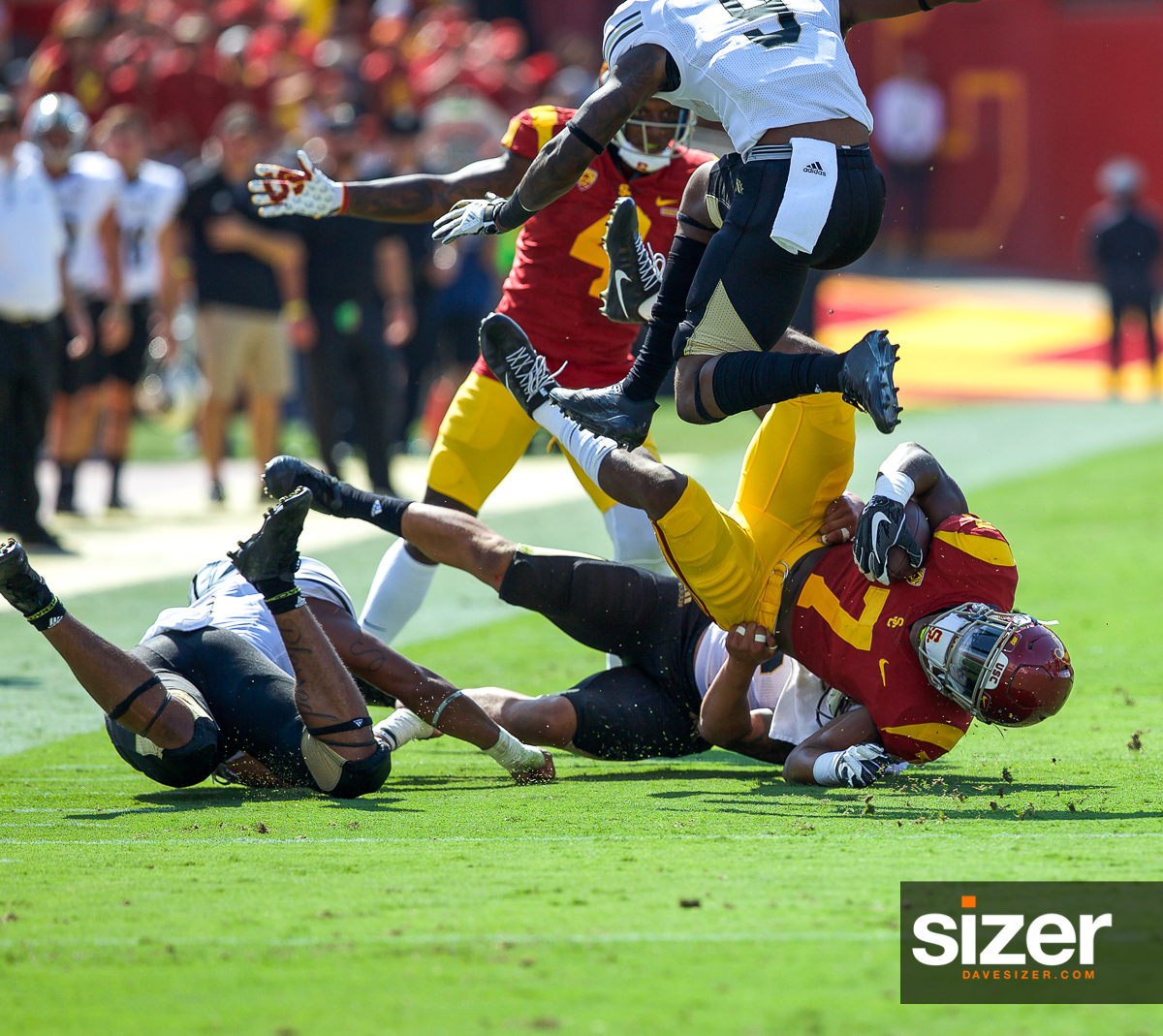 A tangle of bodies as USC TB Stephen Carr is brought down.