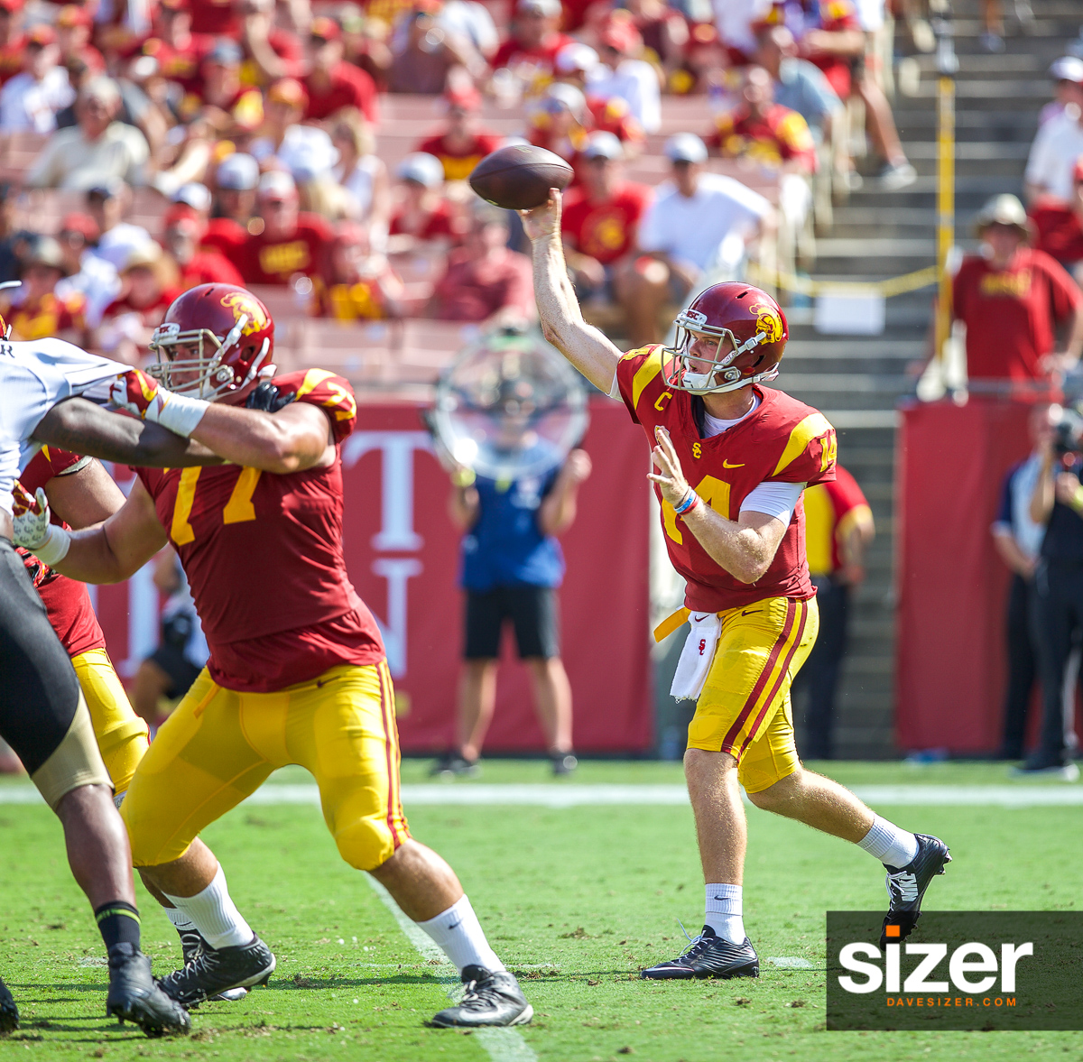 Sam Darnold launches a pass.
